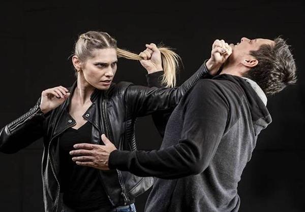 Woman Striking Man
