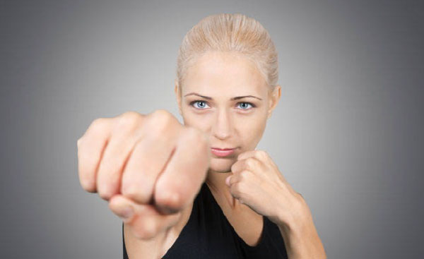 Woman Throwing Punch